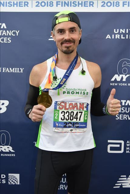 Photo with my 2018 NYC Marathon Medal