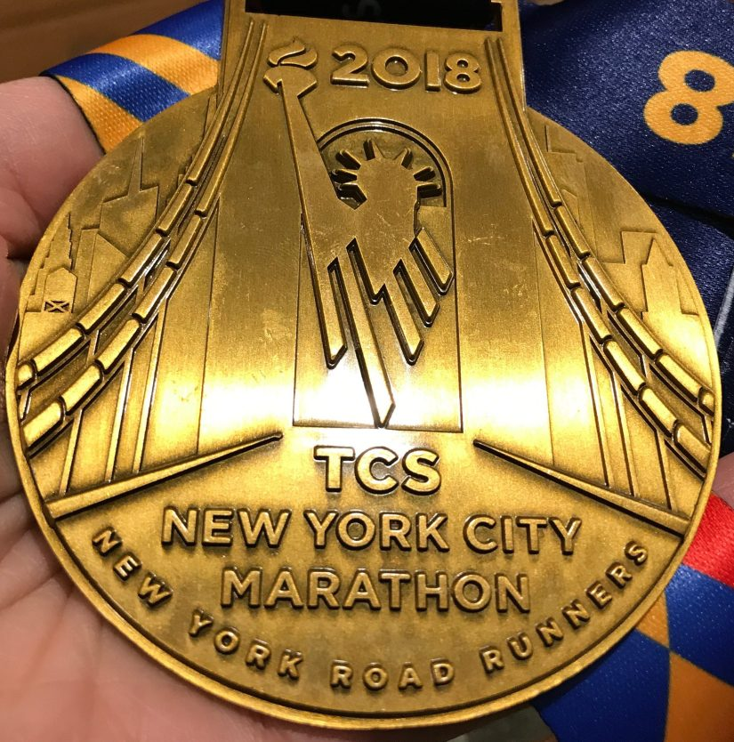 cropped-cropped-nyc-marathon-2018-finisher-medal_sloan-alexander.jpg